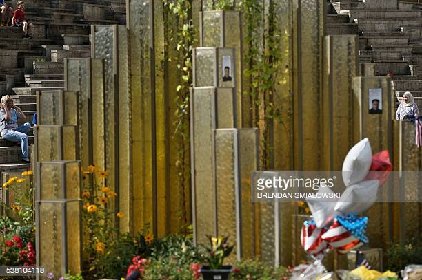 People gather outside the Muhammad Ali center near a makeshift memorial for the boxer June 4 2016 in Louisville Kentucky Ali the threetime world...