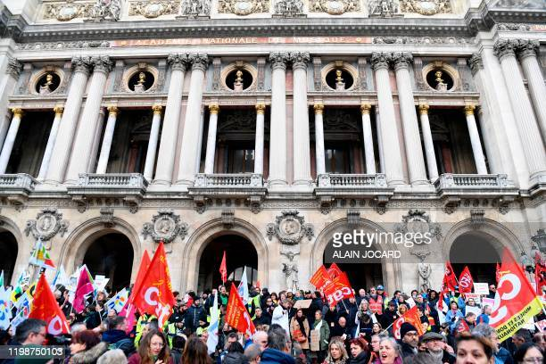 People gather outside the Opera Garnier in Paris on February 5, 2020 after Public sector unions CGT, FAFP, FO, FSU et Solidaires called for a day of...