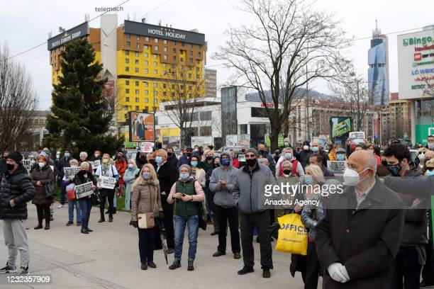 People gather outside the parliament building to stage a protest against Bosnian government's incompetence in fighting against coronavirus pandemic,...