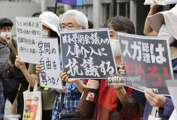 People gather outside the prime minister's office in Tokyo on Oct. 3 to protest against Japanese Prime Minister Yoshihide Suga's decision not to...