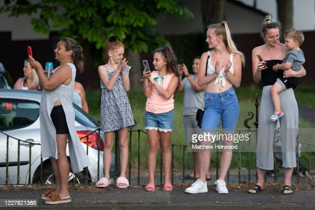 People gather outside the Royal Gwent Hospital to take part in the weekly clap for carers event on May 28, 2020 in Newport, United Kingdom. For 10...