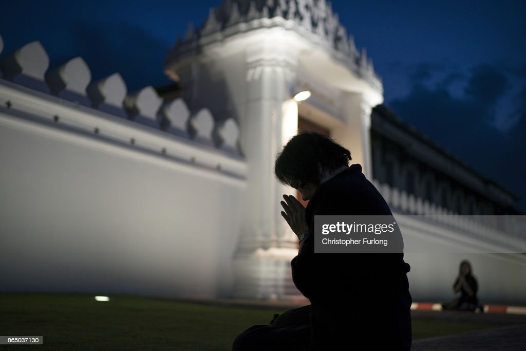 People gather, outside the royal palace, to pay their respects to Thailand's late King Bhumibol Adulyadej as the city prepares for his cremation on October 22, 2017 in Bangkok, Thailand. The world's longest serving monarch King Bhumibol Adulyadej died on October 13, 2016. Rehearsals for the five day funeral of the much loved king are taking place around Bangkok's Grand Palace. The ceremonies will take place over five days culminating in the cremation of the king's body in a grand Royal Crematorium on October 26th.