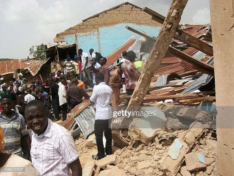 People gather outside the ruins of a church targeted by a suicide bombing in a church in Jos on June 10, 2012. The bomber and two persons were killed and 41 were wounded. On the same day, a second attack in a church killed at least one person and wounded several in the northeastern town of Biu. The assaults were the latest in a series targeting churches in Africa's most populous nation and largest oil producer, with many of the previous attacks claimed by Islamist group Boko Haram.