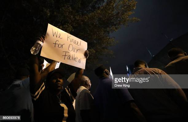 People gather outside the stadium for a NFL Game 'Kneel in' protest before the start of the game between the Carolina Panthers and Philadelphia...