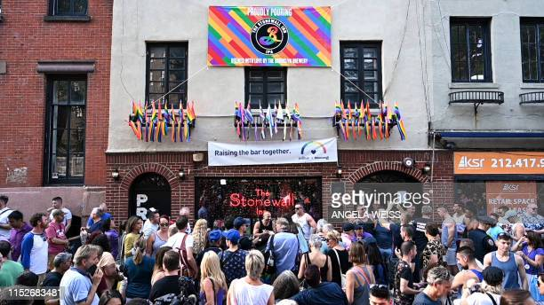 People gather outside the Stonewall Inn to mark the 50th anniversary of the Stonewall Riots in New York June 28 2019 The June 1969 riots sparked by...