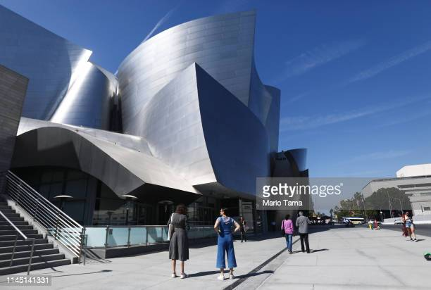 People gather outside the Walt Disney Concert Hall, designed by Frank Gehry, on April 25, 2019 in Los Angeles, California, According to a Bloomberg...