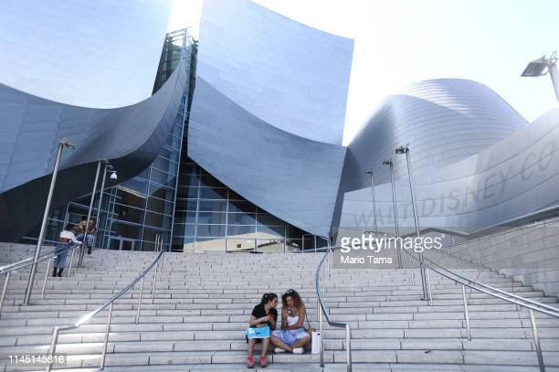 People gather outside the Walt Disney Concert Hall designed by Frank Gehry on April 25 2019 in Los Angeles California According to a Bloomberg study...