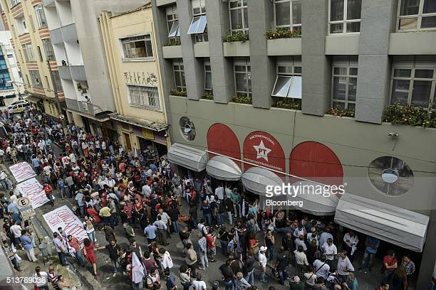 People gather outside the Workers' Party state headquarters while Luiz Inacio Lula da Silva Brazil's former president is detained inside in Sao Paulo...