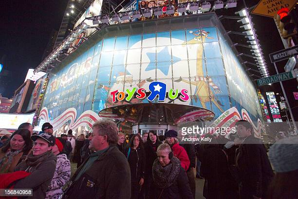 People gather outside Toys R Us for the Black Thursday in Times Square November 22 2012 in New York City The store got a head start on the...
