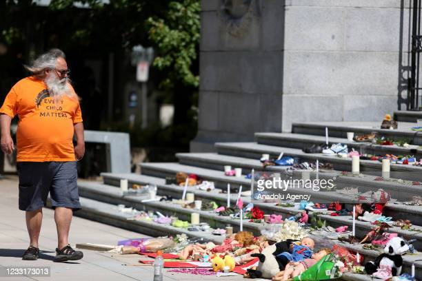 People gather outside Vancouver Art Gallery, where 215 pairs of children's shoes displayed on May 29, 2021 in Vancouver, British Columbia, Canada The...