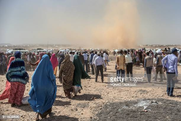 TOPSHOT People gather prior to a food distribution at the Internally displaced person camp of Farburo in Gode near Kebri Dahar southeastern Ethiopia...