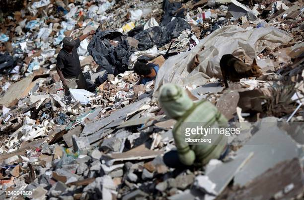 People gather scrap metal in a dump at the La Verbena cemetery in Guatemala City Guatemala on Monday Nov 21 2011 Foreign direct investment in...