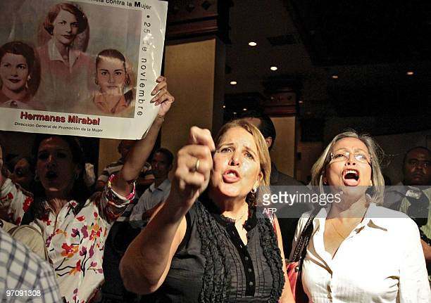 People gather shouting slogans against late Dominican Republic dictator Rafael Trujillo outside a hotel in Santo Domingo on February 25 2010 during...