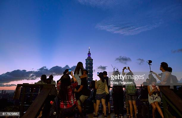 People gather the watch the last light as the sun sets over the city The Elephant Mountain hiking trail is the closest viewpoint to the iconic Taipei...