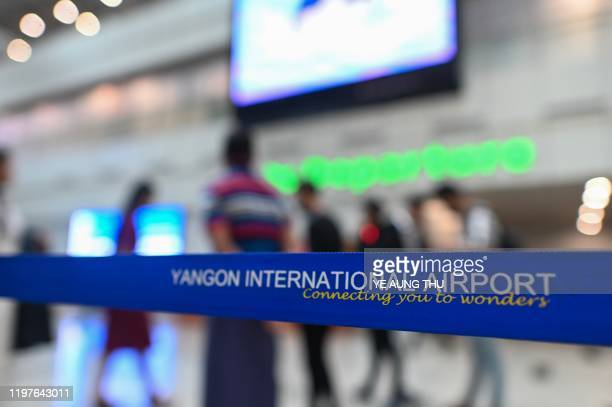 People gather the Yangon international aiport in Yangon on January 31, 2020. - Myanmar airlines suspend their China flights while the World Health...