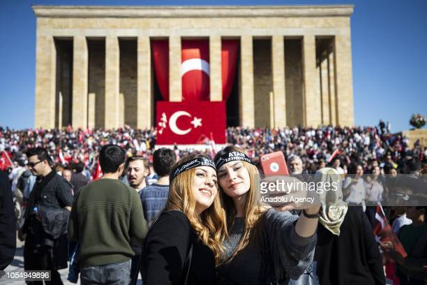 People gather to attend a ceremony marking the 95th anniversary of Republic Day at the Anitkabir the mausoleum of the founder of Turkish Republic...