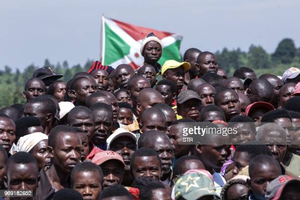 TOPSHOT People gather to attend a ceremony marking the adoption of the new constitution passed in a May referendum on June 7 2018 in Bugendana The...
