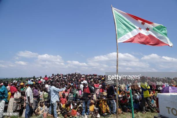 People gather to attend a ceremony marking the adoption of the new constitution passed in a May referendum on June 7 2018 in Bugendana The...