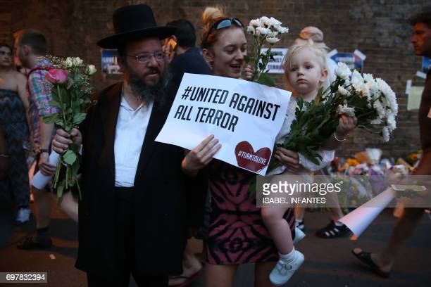 People gather to attend a vigil outside Finsbury Park Mosque close to the scene of a van attack in Finsbury Park north London on June 19 2017 Ten...
