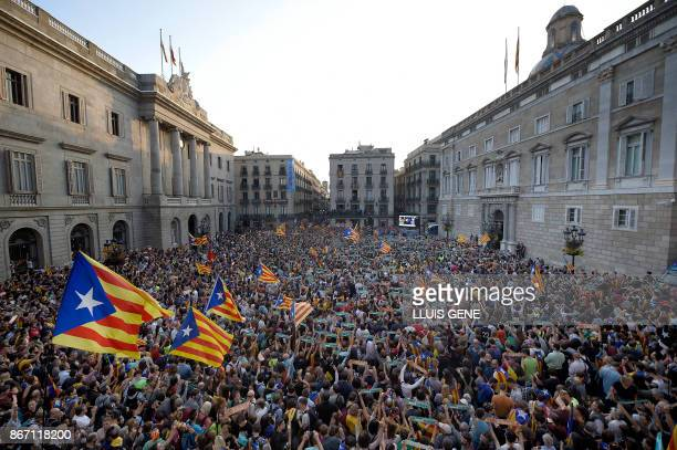 TOPSHOT People gather to celebrate at the Sant Jaume square in Barcelona on October 27 2017 Catalonia's parliament voted to declare independence from...