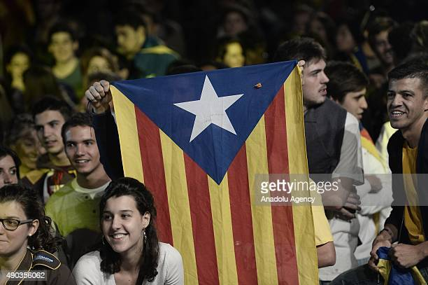 People gather to celebrate the election results after the Catalanist coalition 'Junts pel Si' won the regional elections held at the El Born Culture...