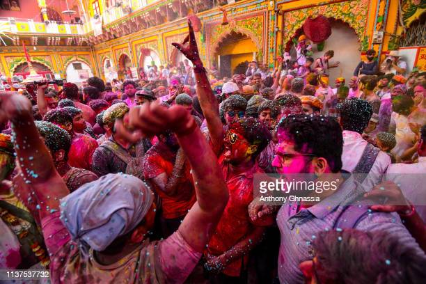 People gather to celebrate the Holi festival at the Dwarkadhish Temple on March 21 2019 in Mathura India