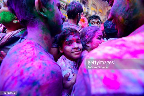 People gather to celebrate the Holi Festival on March 21 2019 At Dwarkadhish Temple in Mathura India