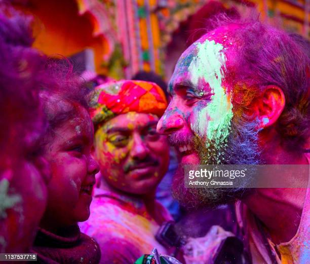 People gather to celebrate the Holi Festival on March 21 2019 At Banke Bihari Temple in Mathura India