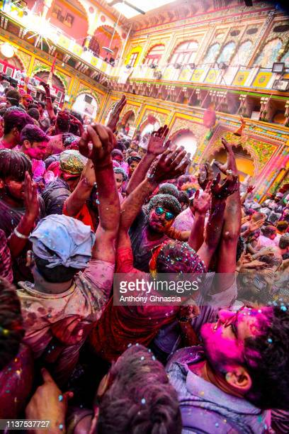 People gather to celebrate the Holi festival on March 21 2019 in Mathura India