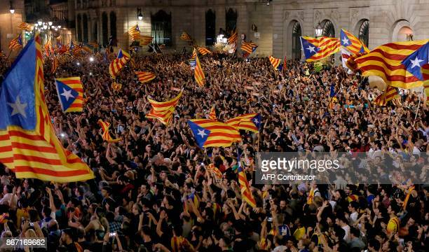 People gather to celebrate the proclamation of a Catalan republic at the Sant Jaume square in Barcelona on October 27 2017 Catalonia's parliament...