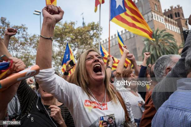 People gather to celebrate the proclamation of a Catalan republic at the Sant Jaume square in Barcelona on October 27, 2017. Catalonia's parliament...