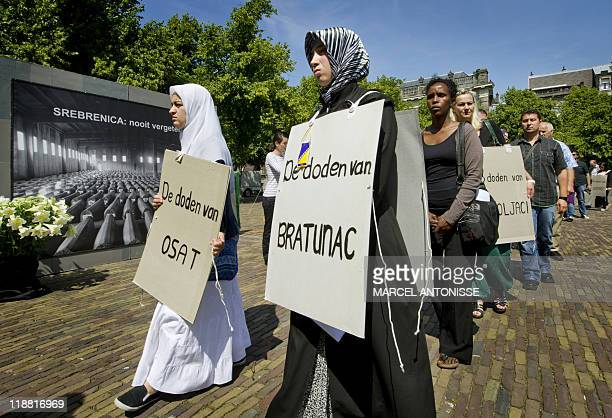 People gather to commemorate the 16th anniversary of the Srebrenica massacre in the Hague on July 11 just weeks after the arrest of its alleged...