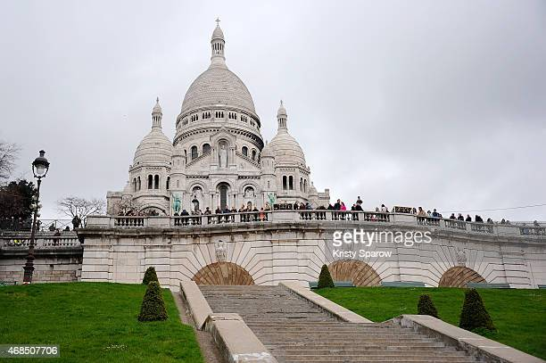 People gather to commemorate the death of Christ during the Good Friday procession at the Sacre Coeur church in Montmartre's Basilica with Cardinal...