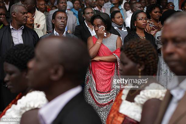 People gather to commemorate the genocide of 1994 at the Kicukiro College of Technology football pitch April 5 2014 in Kigali Rwanda On April 11...
