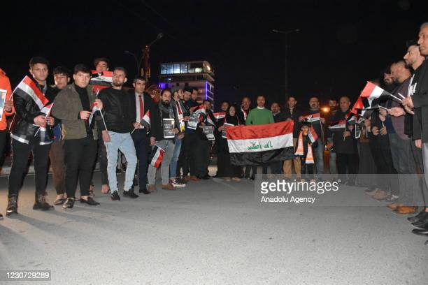 People gather to commemorate the twin suicide bombing attack at al-Tayaran Square in Baghdad carried out by Daesh terrorist organization, on January...