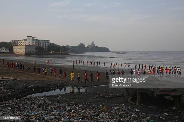 People gather to do fitness training on the beach on November 19 2015 in Conakry Guinea Guinea is currently counting down the necessary 42 days...