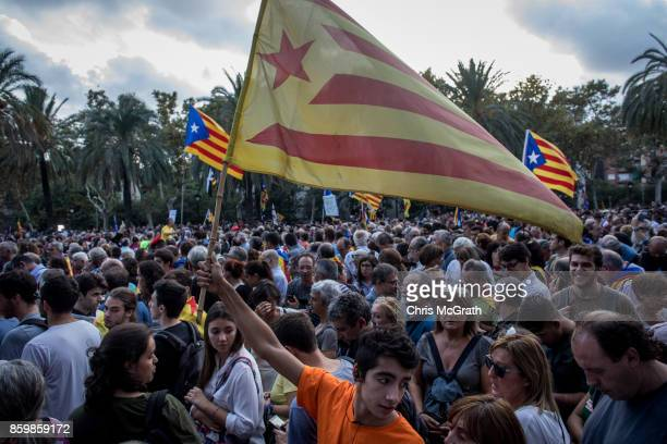People gather to hear Catalan President Carles Puigdemont speak outside the Parliament of Catalunya on October 10 2017 in Barcelona Spain After the...