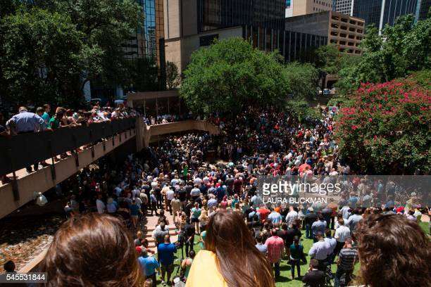 TOPSHOT People gather to hold a faith vigil at ThanksGiving Square in Dallas Texas on July 8 following the shootings during a peaceful protest on...