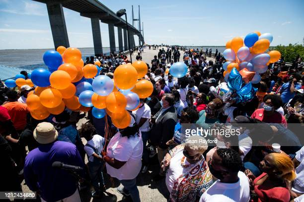 People gather to honor Ahmaud Arbery at Sidney Lanier Park on May 9 2020 in Brunswick Georgia Arbery was shot and killed while jogging in the nearby...