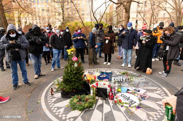 People gather to honor John Lennon on the 40th anniversary of his death at Strawberry Fields memorial in Central Park on December 08, 2020 in New...
