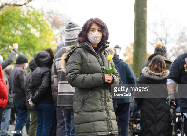 People gather to honor John Lennon on the 40th anniversary of his death at Strawberry Fields in Central Park on December 08, 2020 in New York City....