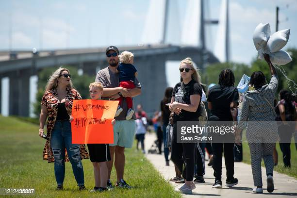 People gather to honor the life of Ahmaud Arbery at Sidney Lanier Park on May 9, 2020 in Brunswick, Georgia. Arbery was shot and killed while jogging...