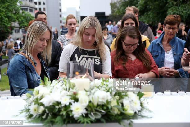 People gather to honour Grace Millane in St Patricks Square on December 12 2018 in Auckland New Zealand The body of 22yearold Grace Millane was found...