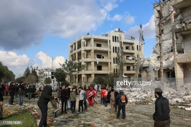 People gather to inspect the site after the consecutive bomb attacks with two bombladen vehicles in Idlib city centre Syria on February 18 2019 Nine...