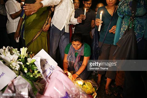 People gather to lay candles at a memorial site for victim Prabha Arun Kumar on March 11 2015 in Sydney Australia The fatal stabbing of Prabha Arun...