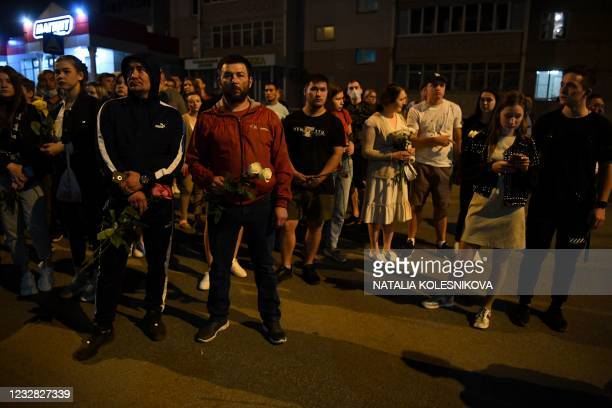 People gather to lay flowers and toys at a makeshift memorial for victims of the shooting at School No. 175 in Kazan on May 11, 2021. - At least nine...