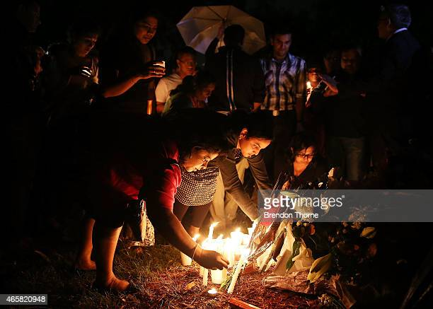 People gather to lay flowers at a memorial site for victim Prabha Arun Kumar on March 11 2015 in Sydney Australia The fatal stabbing of Prabha Arun...