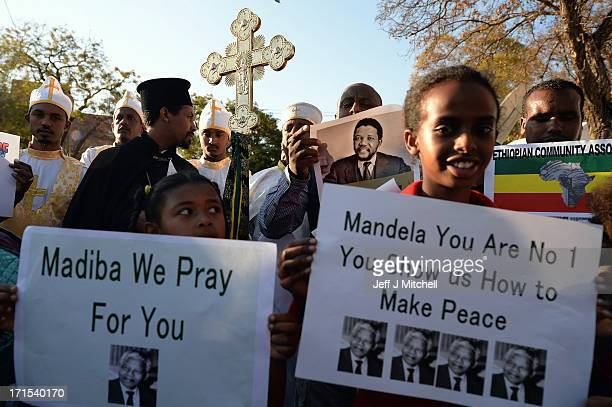 People gather to leave messages of support for former South African President Nelson Mandela outside the Mediclinic Heart Hospital June 26 2013 in...