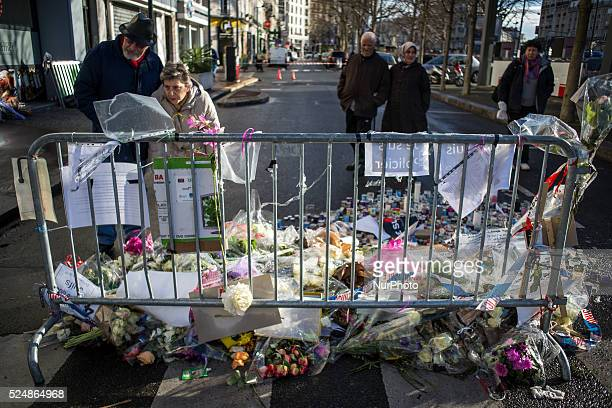People gather to light candles give wreath of flowers after the hostage taking last week at the supermarket quothypercacherquot in Vincennes near...