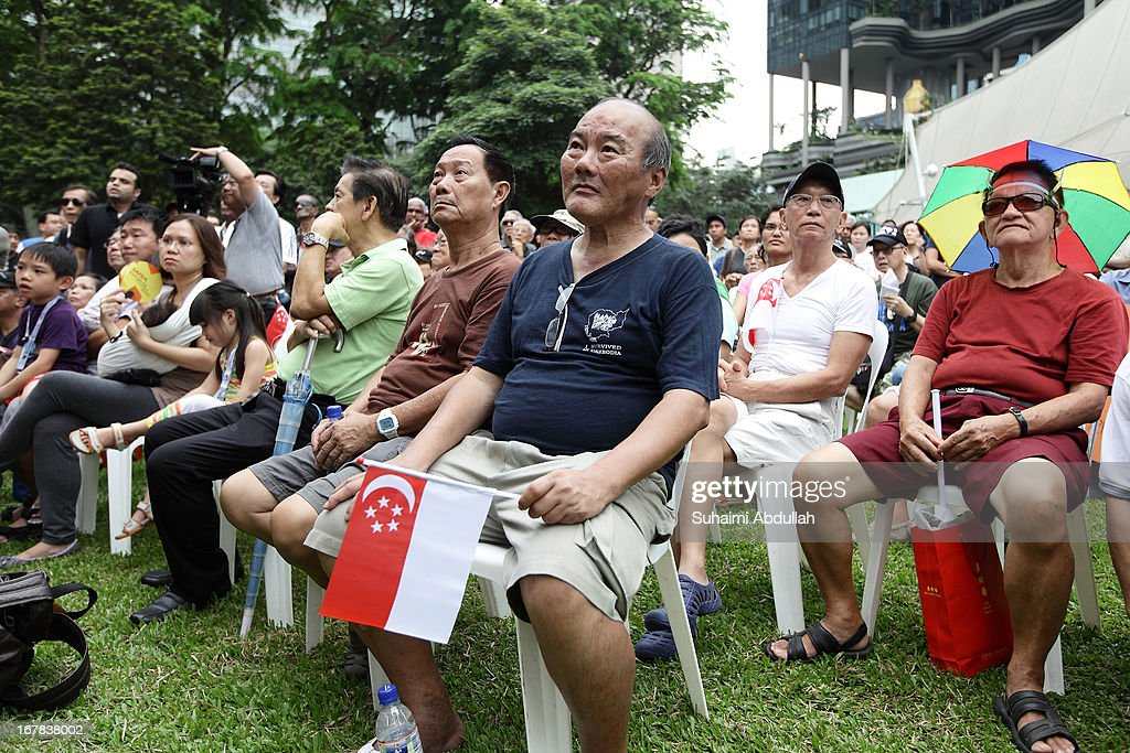 People gather to listen to a speaker during a protest against the government's White Paper on Population and labour-related matters that affect Singaporeans at Speakers' Corner in Hong Lim Park on May 1, 2013 in Singapore.Thousands of protesters gathered today in an inaugural labour day protest against the 6.9 million population government white paper that revealed it could increase 30% to 6.9 million by 2030, angering residents who already see a strain on housing, transportation and healthcare. This is a follow up protest after one was held on 16 Feb, 2013 organised by the same organiser, transitioning.org